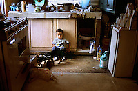 Texas, Rio Grande Valley. Boy in his home.