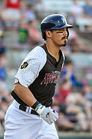 Milwaukee Brewers shortstop Tyler Saladino (17) runs to first base during a rehab outing with the Wisconsin Timber Rattlers in a Midwest League game against the Clinton LumberKings on June 29, 2018 at Fox Cities Stadium in Appleton, Wisconsin. Clinton defeated Wisconsin 9-7. (Brad Krause/Four Seam Images)