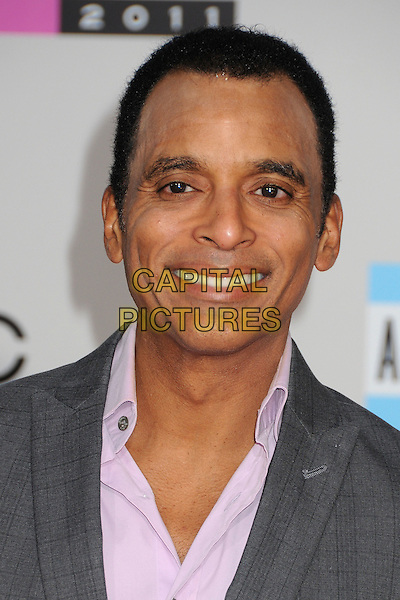 Jon Secada.2011 American Music Awards - Arrivals held at Nokia Theatre LA Live, Los Angeles, California, USA..November 20th, 2011.ama amas ama's headshot portrait purple shirt grey gray.CAP/ADM/BP.©Byron Purvis/AdMedia/Capital Pictures.