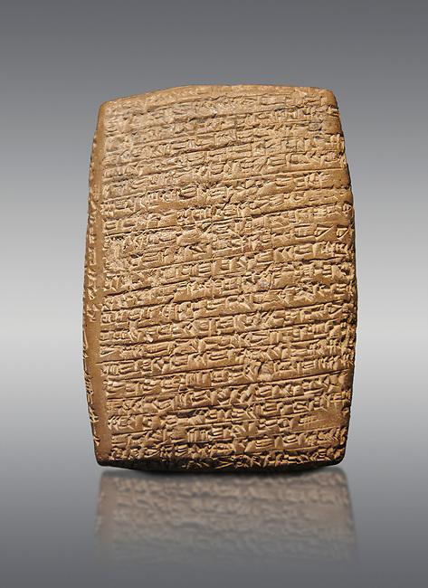 Hittite cuneiform tablet. Adana Archaeology Museum, Turkey. Against a grey background
