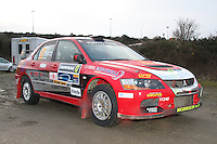 John Morrison - Peter Carstairs in a Mitsubishi Lancer Evolution 9 at the Noise Test which took place at the Tulloch Stadium, Inverness for the 2014 Arnold Clark/Thistle Hotel Snowman Rally supported by Highland Office Equipment, part of the Capital Document Solutions which was organised by Highland Car Club and based in Inverness on 22.2.14; Round 1 of the 2014 RAC MSA Scottish Rally Championship sponsored by ARR Craib Transport Limited.