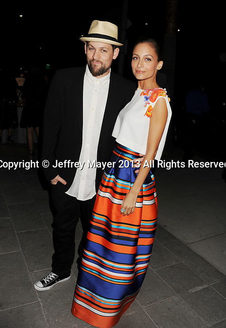 CULVER CITY, CA- NOVEMBER 09: Musician/singer Joel Madden (L) and TV personality/wife Nicole Richie arrive at the 2nd Annual Baby2Baby Gala at The Book Bindery on November 9, 2013 in Culver City, California.