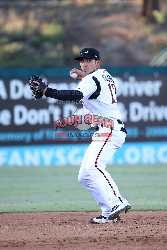 Javier Guerra (12) of the Lake Elsinore Storm makes a throw during a game against the High Desert Mavericks at The Diamond on April 27, 2016 in Lake Elsinore, California. High Desert defeated Lake Elsinore, 10-2. (Larry Goren/Four Seam Images)