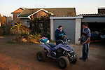 KLEINFONTEIN, SOUTH AFRICA - JULY 15: Residents of the all white Kleinfontein community arrives at their house in a quad bike on July 15, 2013 in Kleinfontein outside Pretoria, South Africa. The all white town with about one thousand residents are all Afrikaners with a Vortrekker heritage. Only white Afrikaners who share Afrikaner culture, language and religion are allowed to settle in the town. (Photo by: Per-Anders Pettersson)
