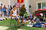 AUG. 12, 2012 - OCEANSIDE, NEW YORK U.S. - As a friend of the Buckley family put it: the young man sitting at the makeshift memorial is (symbolically) having a meal with his older brother, Lance Corporal Greg Buckley, Jr, the 21-year-old Marine from Long Island killed in Afghanistan 3 days earlier.