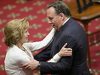 CAQ leader Francois legault gives his condolences to Lisette Lapointe, wife of former Quebec premier Jacques Parizeau, as her husband lies in state at the National Assembly in Quebec City on Sunday June 7, 2015.