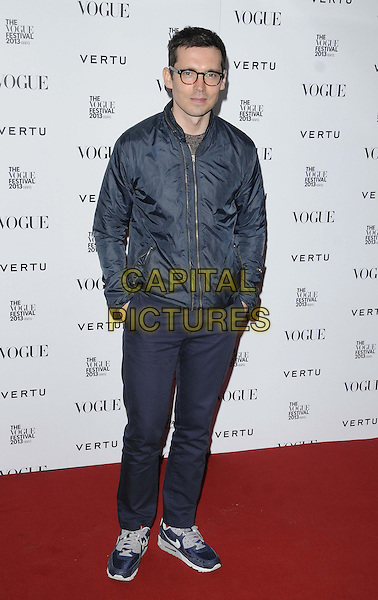 Erdem Moralioglu.attended the Vogue Festival 2013 opening party, Queen Elizabeth Hall, South Bank, London, England..April 27th, 2013.full length blue black jacket trousers hands in pockets glasses   .CAP/CAN.©Can Nguyen/Capital Pictures.