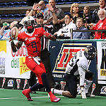 SIOUX FALLS, SD - MARCH 17:  James Terry #9 from the Sioux Falls Storm celebrates a first down past Abraham Woodard #25 from the Wyoming Calvary in the first quarter of their game Sunday afternoon at the Sioux Falls Arena. (Photo by Dave Eggen/Inertia)