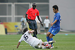 07 August 2008: Sacha Kljestan (USA) (16) tries to tackle the ball away from Keisuke Honda (JPN) (8) as referee Badara Diatta (SEN) watches the play.  The men's Olympic team of the United States defeated the men's Olympic soccer team of Japan 1-0 at Tianjin Olympic Center Stadium in Tianjin, China in a Group B round-robin match in the Men's Olympic Football competition.
