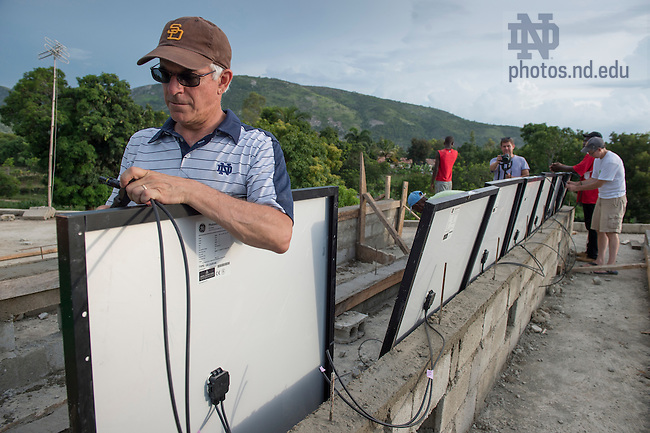 Aug. 11, 2015; Bill Jordan and crew install 26 solar panels on the roof of St. Gabriel School in Fontaine, Haiti. (Photo by Barbara Johnston/University of Notre Dame)