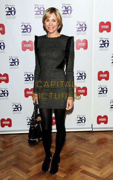 JENNI FALCONER .Elemis 20th Anniversary Party - Inside Arrivals, One Marylebone, London, England, UK, February 2nd 2010..full length dress wool shoulder pads black ruffle tights bag grey gray sleeves long sleeved .CAP/CJ.©Chris Joseph/Capital Pictures.