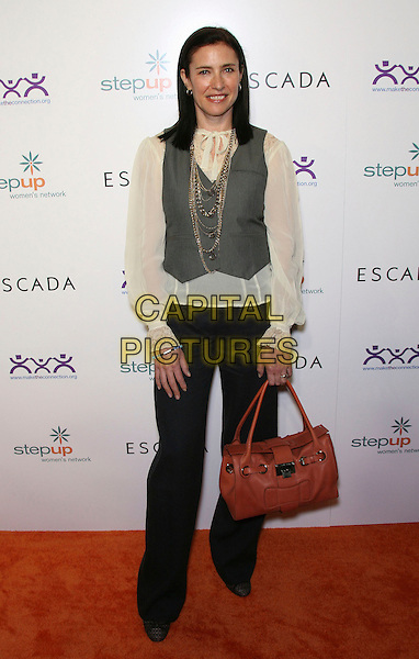 MIMI ROGERS.Step Up Women's Network Inspiration Awards sponsored .by Escada - Arrivals held at The Beverly Hilton Hotel, Beverly Hills, California, USA..April 27th, 2006.Photo: Zach Lipp/AdMedia/Capital Pictures.Ref: ZL/ADM.full length blue trousers grey gray vest orange bag purse.www.capitalpictures.com.sales@capitalpictures.com.© Capital Pictures.
