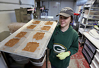 NWA Democrat-Gazette/DAVID GOTTSCHALK Greer Ripley, molder, moves fresh bars to the walk in Wednesday, July 3, 2019, at the Kyya Chocolate Factory and Tasting Room in Elm Springs. Kyya was the first bean to bar chocolate comparing in Arkansas and the name comes from the Greek, KAIA, which means pure, simple, or straight forward.
