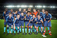 Spurs players pose with the winning trophy during the Gwen and Jim Mann Academy Challenge Cup Match between MK Dons U15 & Tottenham Hotspur U15 at stadium:mk, Milton Keynes, England on 26 April 2019. Photo by Andy Rowland.