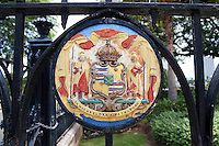 Royal Hawaiian coat of arms plaque on wrought iron gate at the Iolani Palace, Honolulu, Oahu, Hawaii