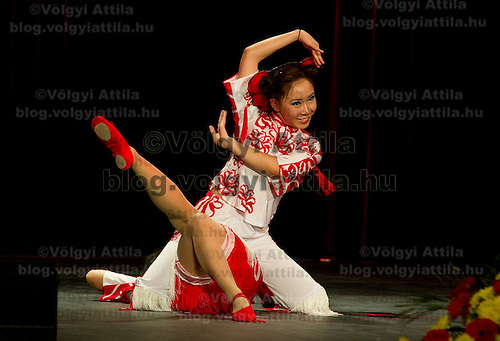 Peiyang Dance Ensemble performs Paper cutting dance choreographed by Liu Rui during the lunar new year gala program organized by the Confucius Institute of ELTE University in Budapest, Hungary on February 16, 2011. ATTILA VOLGYI