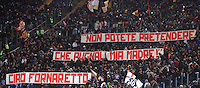 """Calcio, Serie A: Roma vs Cagliari. Roma, stadio Olimpico, 25 novembre 2013.<br /> AS ROma fans exhibit a banner reading """"You can't pretend I stab my mother. Goodbye little baker"""" aimed to past forward Amedeo Amadei prior to the start of the Italian Serie A football match AS Roma and Cagliari between AS Roma and Cagliari at Rome's Olympic stadium, 25 November 2013. Amadei passed away on 24 November at 92.<br /> UPDATE IMAGES PRESS/Isabella Bonotto"""