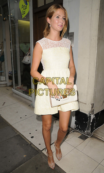 Millie Mackintosh  .The Candy Kittens pop up shop launch party, Candy Kittens, London, England, August 7th, 2012.full length yellow white sleeveless lace dress clutch bag wedges .CAP/CAN.©Can Nguyen/Capital Pictures.