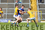 Chris O'Donoghue and Cian Horan Glenflesk stop John Spillane Templenoe in action during the Intermediate Championship semi final in Fitzgerald Stadium on Sunday
