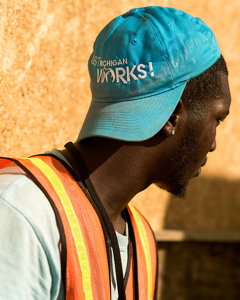 August 6, 2016. Flint, Michigan. <br />  Zanando Jacobs, works at a bottled water distribution point in Flint. He is part of the Michigan Works program with puts Flint residents to work while giving them on the job training. <br />  Although Flint city government says their water is safe to drink when filtered properly, many residents still rely on bottled water for drinking and bathing. Through federal emergency funds, the state distributes 1000's of cases of bottled water nearly every day to Flint residents.<br />  In April 2014, the city of Flint switched its water source from the Detroit Water and Sewerage Department to using the Flint River in an effort to save money. When the switch occurred, the city failed to have corrosion control treatment in place for the new water. This brought about a leaching of lead from pipes into the water, increasing the lead content in the drinking water to levels far above legal limits. After independent sources brought this to light, the city admitted the water was unsafe and legal battles have ensued between resident and the local and state governments.