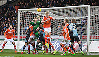 Goalkeeper Elliot Justham of Luton Town & Cameron McGeehan of Luton Town clear a Wycombe attack during the Sky Bet League 2 match between Wycombe Wanderers and Luton Town at Adams Park, High Wycombe, England on 6 February 2016. Photo by Massimo Martino.