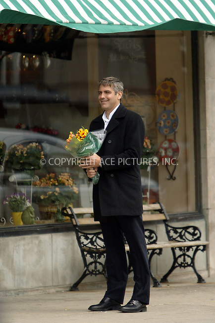 George Clooney filming 'Ocean's 12' in Chicago suburb, Lake Forrest, Illinois. April 19, 2004. In this scene Glooney's character, Danny, is seen buying flowers and some jewelry for Julia Roberts' character, Tess. Please byline: ACE Pictures.   ..*PAY-PER-USE*      ....IMPORTANT: Please note that our old trade name, NEW YORK PHOTO PRESS (NYPP), is replaced by our new name, ACE PICTURES. New York Photo Press and ACE Pictures are owned by All Celebrity Entertainment, Inc.......All Celebrity Entertainment, Inc:  ..contact: Alecsey Boldeskul (646) 267-6913 ..Philip Vaughan (646) 769-0430..e-mail: info@nyphotopress.com