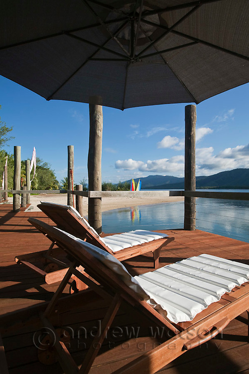 Sun lounges on deck at Double Island resort. Palm Cove, Cairns, Queensland, Australia