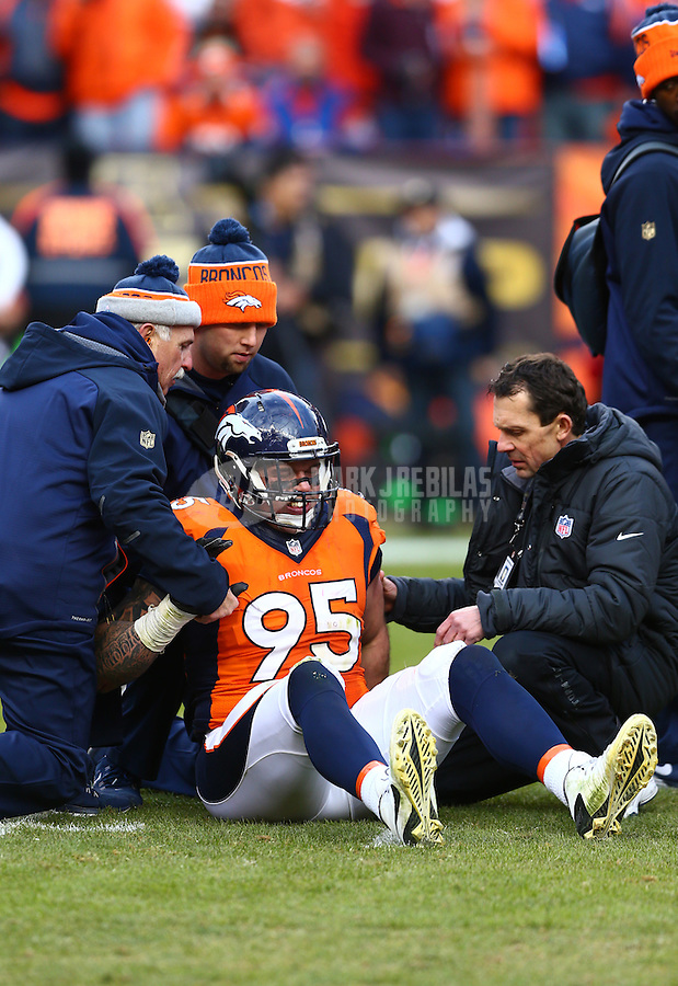 Jan 24, 2016; Denver, CO, USA; Denver Broncos defensive end Derek Wolfe (95) is tended to by trainers after suffering an injury against the New England Patriots in the AFC Championship football game at Sports Authority Field at Mile High. The Broncos defeated the Patriots 20-18 to advance to the Super Bowl. Mandatory Credit: Mark J. Rebilas-USA TODAY Sports