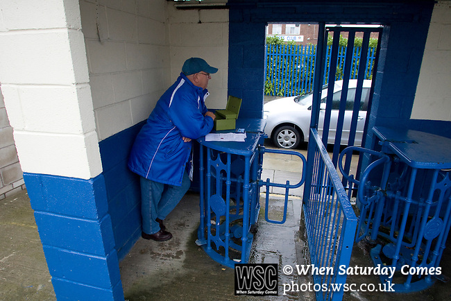 The turnstile operator at Cammell Laird FC waiting for spectators to arrive beforeLairds take on Guiseley in a Unibond League premier division game at Kirklands, Birkenhead. Lairds beat their visitors, who were lying second in the table by 5 goals to 4 on front of a crowd of just 112. Formed in 1907, Lairds joined the English pyramid in 2004 and gained three promotions in five years, but financial problems forced the club to revert to amateur status in December 2008.