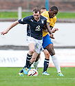 Dundee's Craig Beattie holds off Cowdenbeath's Nathaniel Wedderburn.