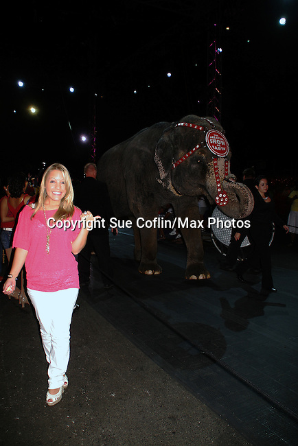 Kristen poses one of the elephant at preshow - One Life To Live's Kristen Alderson was guest host and signed autographs at The Coney Island Illuscination presented by Ringling Bros. and Barnum & Bailey - The Greatest Show on Earth on August 28, 2010 at Coney Island Boardwalk, New York. (Photo by Sue Coflin/Max Photos)