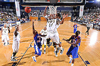 12 November 2010:  FIU's Marvin Roberts (11) and Phil Gary, Jr. (4) attempt to block a shot by Florida Memorial's Roderick Davis (3) in the first half as the FIU Golden Panthers defeated the Florida Memorial Lions, 89-73, at the U.S. Century Bank Arena in Miami, Florida.