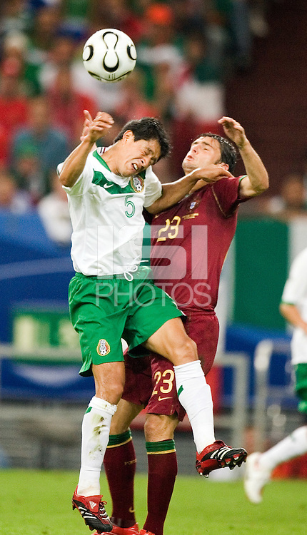 Postiga Helder (23) of Portugal in action against Ricardo Osorio (5) of Mexico. Portugal defeated Mexico 2-1 in their FIFA World Cup Group D match at FIFA World Cup Stadium, Gelsenkirchen, Germany, June 21, 2006.