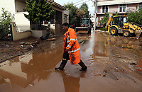 Pictured: A man walks on one of the many mud covered roads..<br /> Re: People have died, some still missing and severe damage caused by heavy rain and flash flooding in the area of Mandra, near Athens, Greece. Thursday 16 November 2017