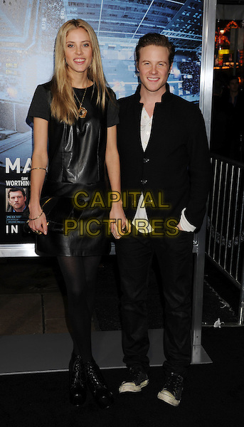 Tasha Franken & Ashton Holmes.L.A. Premiere of 'Man on a Ledge' held at The Grauman's Chinese Theatre in Hollywood, California, USA..January 23rd, 2012.full length black dress tights jacket jeans denim clutch bag holding hands.CAP/ROT/TM.©Tony Michaels/Roth Stock/Capital Pictures