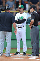 Manager Scott Steinmann #22 of the Clinton LumberKings meets with South Bend manager and umpires  prior to the game against the South  Bend Silver Hawks at Ashford University Field on July 26, 2014 in Clinton, Iowa. The Sliver Hawks won 2-0.   (Dennis Hubbard/Four Seam Images)