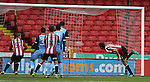 Chris Basham of Sheffield Utd stoops to score the first goal during the Emirates FA Cup Round One match at Bramall Lane Stadium, Sheffield. Picture date: November 6th, 2016. Pic Simon Bellis/Sportimage