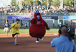 The Aces mascot Archie races against kids wearing clown shoes in between innings.  Photo by Tom Smedes.