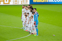 Sunday 9th November 2014<br /> Pictured: Players observe a minutes silence at the Liberty stadium  <br /> Re: Barclays Premier League Swansea City v Arsenal at the Liberty Stadium, Swansea, Wales,UK