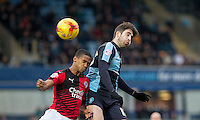 Max Kretzschmar of Wycombe Wanderers beats Lewis Young of Crawley Town in the air during the Sky Bet League 2 match between Wycombe Wanderers and Crawley Town at Adams Park, High Wycombe, England on 28 December 2015. Photo by Andy Rowland / PRiME Media Images