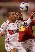 Chicago Fire midfielder (14) Chris Armas plays the ball in front of Red Bulls defender (2) Marvell Wynne. The Red Bulls defeated the Fire 1-0 in an MLS regular season match at Giants Stadium, East Rutherford, NJ, on Sep 30, 2006.