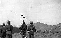 BNPS.co.uk (01202 558833)<br /> Pic: HannBooks/BNPS<br /> <br /> PICTURED: A supply drop during the operation<br /> <br /> Remarkable photos taken deep behind enemy lines by an SAS unit during a daring wartime operation have come to light on the 75th anniversary of the mission. <br />  <br /> The little-known Operation Galia on the 27th December 1944 involved just 33 SAS men hoodwinking the Nazis and their fascist allies into thinking a much greater force had landed behind them in Italy in December 1944.<br />  <br /> Adolf Hitler's forces had just launched a major surprise offensive in the Ardennes Forest in Belgium that became known as the Battle of the Bulge.<br /> <br /> Robert Hann, whose late father was SAS Paratrooper Stanley Hann, retraced his father's wartime experiences and part of his [father's] epic 80 mile long escape route through the Apennine mountains which the men took, to help him write the book 'SAS Operation Galia.'