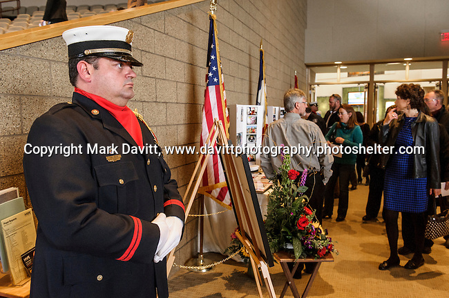 Jody Miller of Indianola's Honor Guard stands watch before a celebration of life for former Indianola Fire Chief Brian Seymour Saturday at Lutheran  Church of Hope. Seymour died March 12 after an accident at his home in Texas.