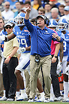 Head coach Mark Stoops of the Kentucky Wildcats directs his team during the second half of the TaxSlayer Bowl against the Georgia Tech Yellow Jackets at EverBank Field on Saturday, December 31, 2016 in Jacksonville, Florida. Photo by Michael Reaves | Staff.