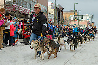 Ketil Reitan's handler brings the dogs to the 4th avenue start line during the Ceremonial Start of the 2016 Iditarod in Anchorage, Alaska.  March 05, 2016