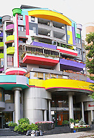 A very colourful building. Street scene from the part of the city called The Block that used to be reserved for party dignitaries during the communist era. Tirana capital. Albania, Balkan, Europe.