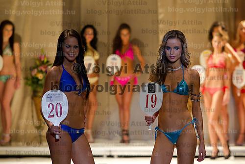 Andrea Makk (left) and Zsofia Huszar (right) attends the Miss Hungary 2010 beauty contest held in Budapest, Hungary on November 29, 2010. ATTILA VOLGYI