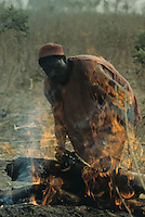 Caster blacksmith preparing the charcoal  using wood of Acacia nilotica.