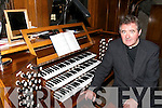 MUSIC: Canon William Crean at the Megaghy Organ which is being restored in the O'Connell Memorial Church of the Holy Cross in Caherciveen..