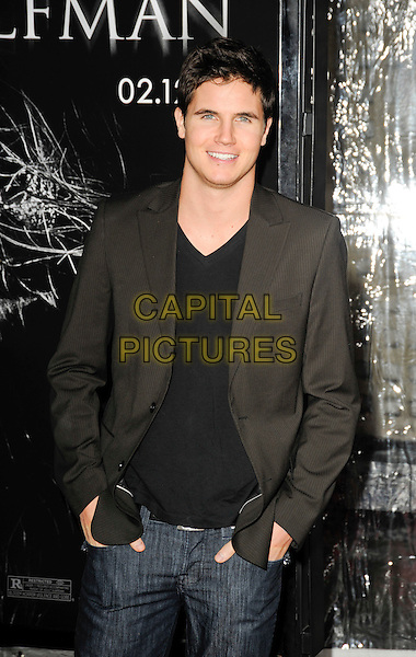 "ROBBIE AMELL.""The Wolfman"" Los Angeles Premiere held at Arclight Cinemas, Hollywood, California, USA, .9th February 2010.arrivals half length jeans black grey gray blazer jacket hands in pockets .CAP/ROT.©Lee Roth/Capital Pictures"